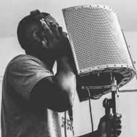 Atlanta voiceover talent recording vocals for audio project