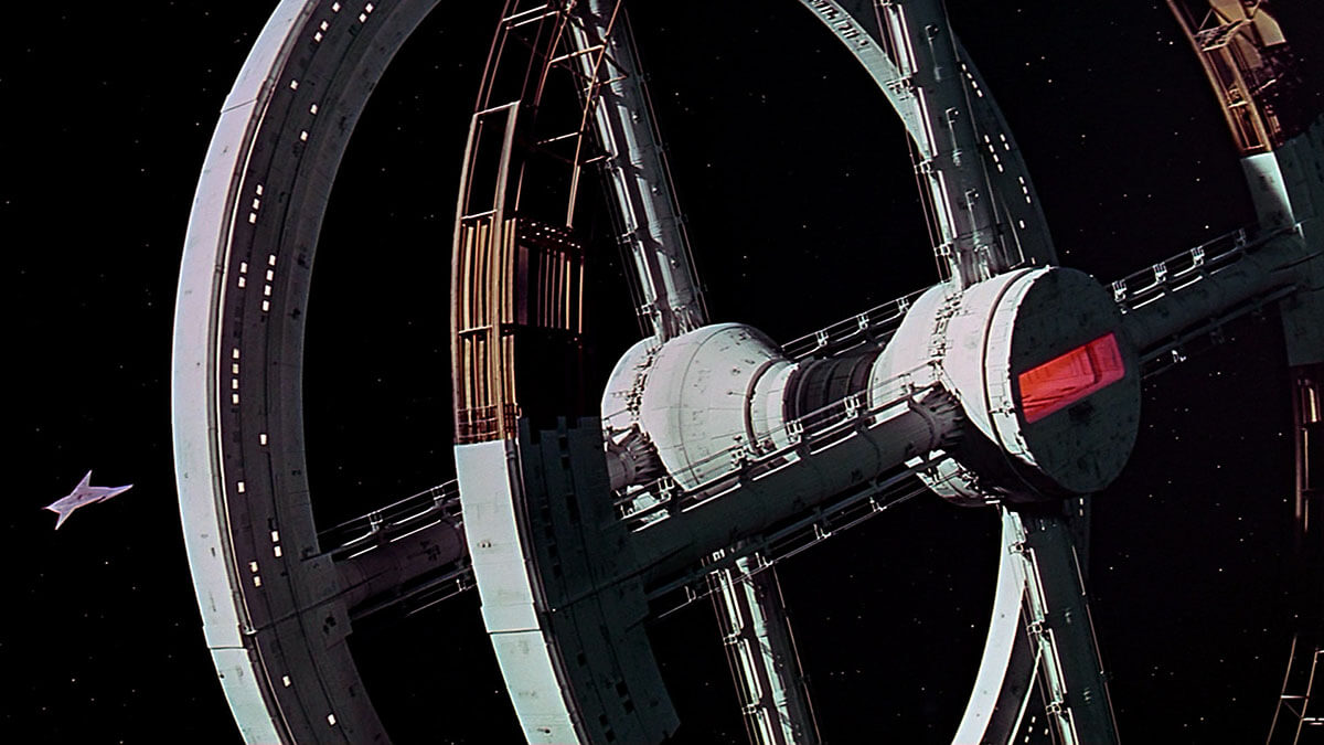 A spacecraft approaches a docking station.