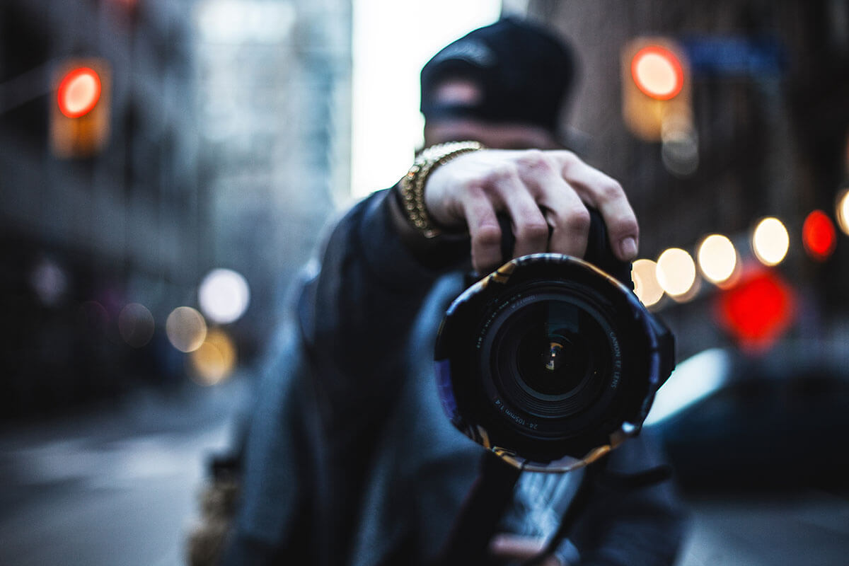 A creative professional photographer takes a picture.