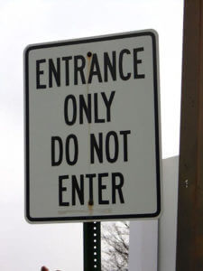 "A confusing street sign says, ""Entrance only. Do not enter."""
