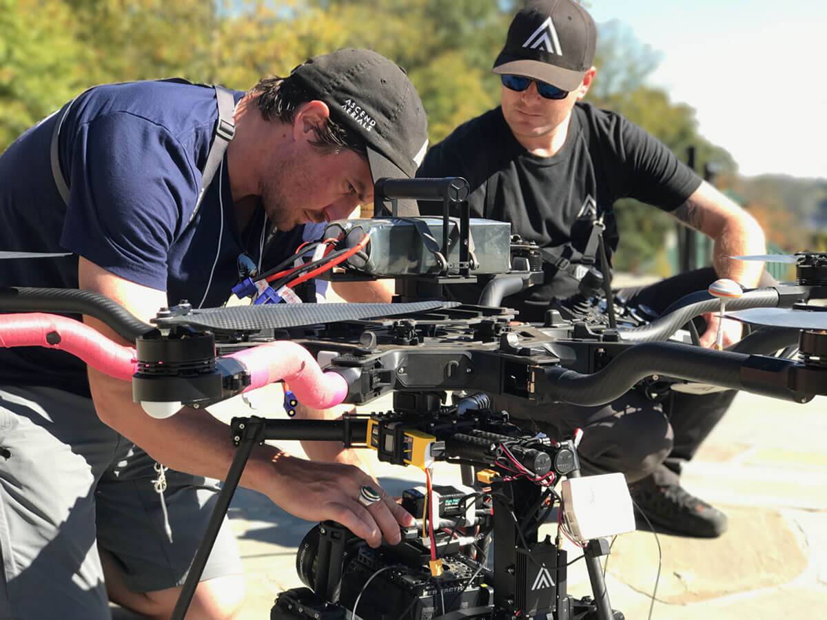 Two men from FAA-licensed Ascend Aerials work behind the scenes to prepare an octocopter to film a 2018 demo reel.