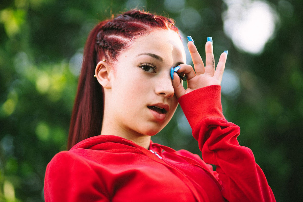 Danielle Bregoli's Bhad Bhabie wearing a red zip up sweat shirt.