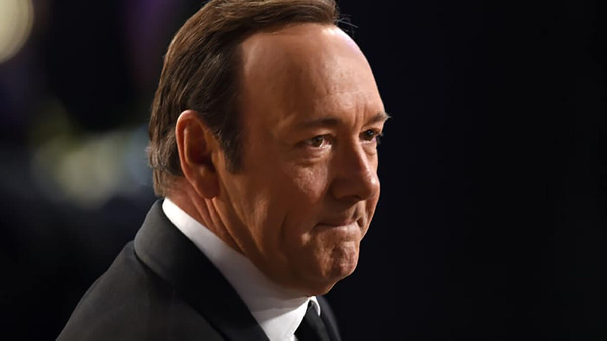 Kevin Spacey in a black suit and tie