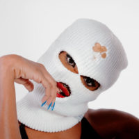"Woman in ""Lil' Freak"" music video wears a balaclava."