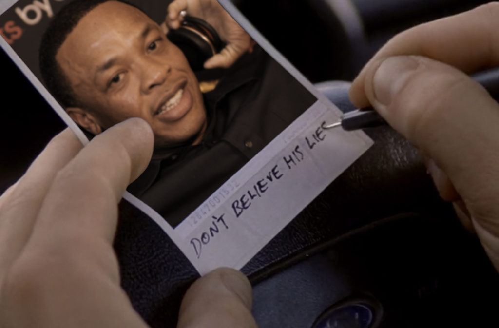 "Dr. Dre with Beats Headphones inside of a Polaroid picture reminiscent of the movie ""Momento."" At the bottom, someone is writing ""Don't believe his lies."""