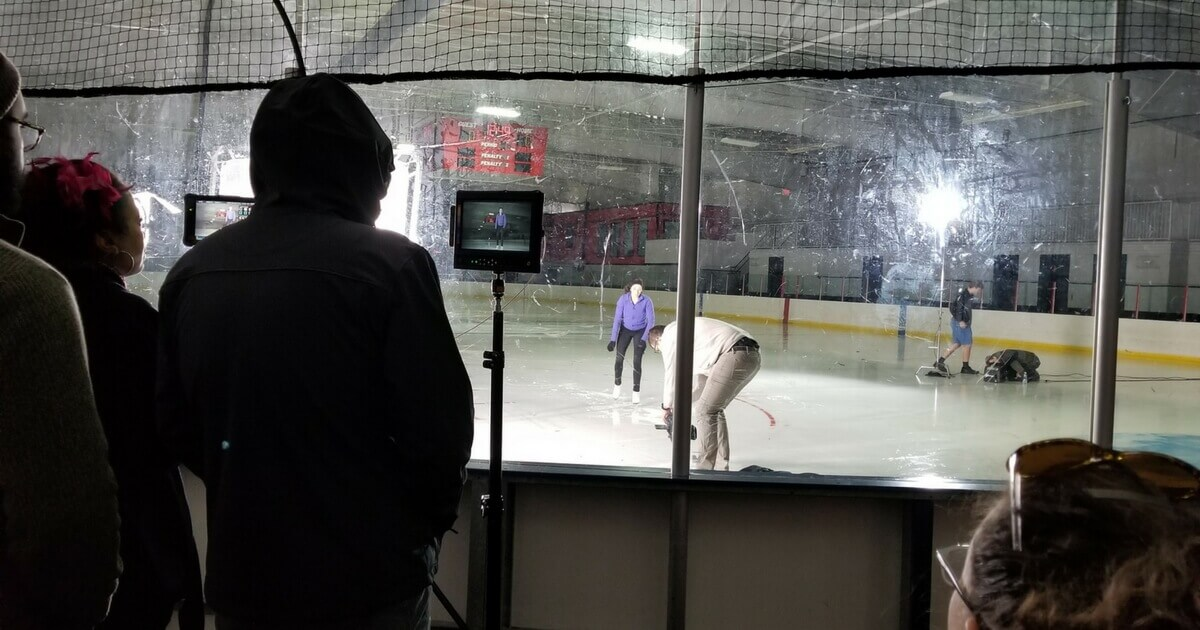 Medical TV commercial production filming in an ice rink.