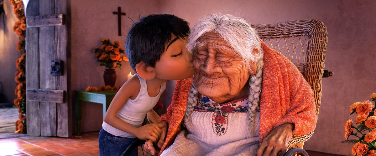 Miguel gives Mama Coco a kiss.
