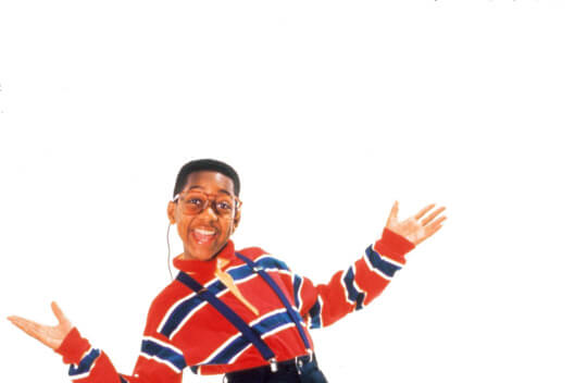 Steve Urkel classic look with him leaning back in glasses and suspenders with his arms open.