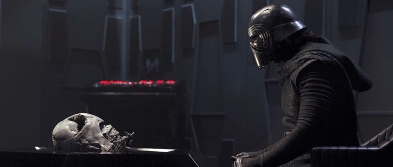 Kylo Ren stares at Darth vader's helmet.
