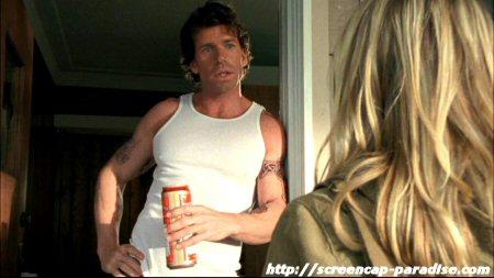 Taylor Sheridan leaning against a door frame on Veronica Mars.