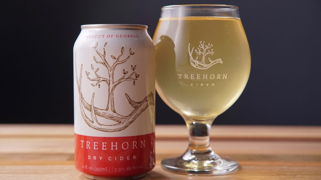 A TreeHorn Cider can and glass