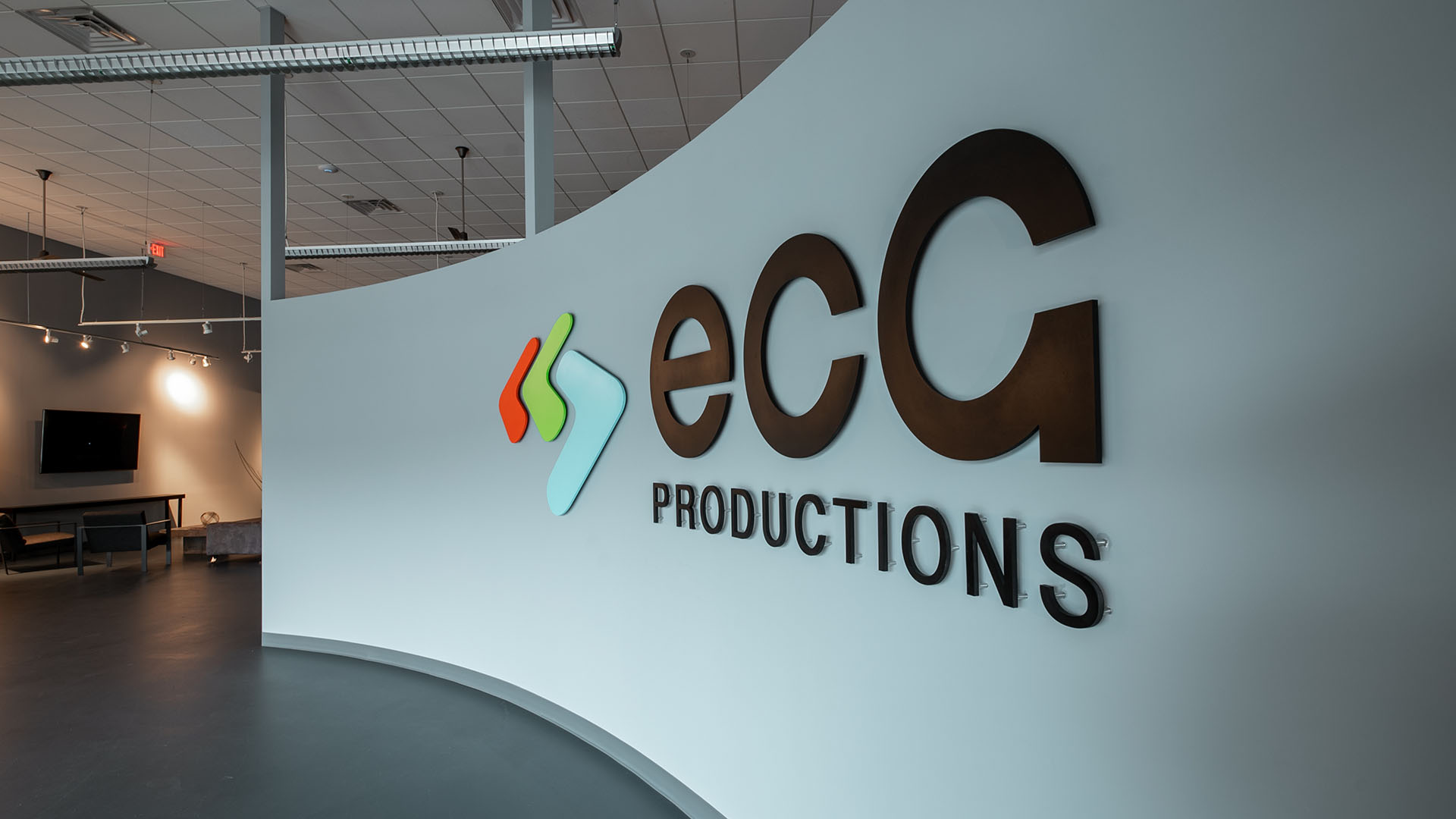 ECG Productions logo at the lobby entrance