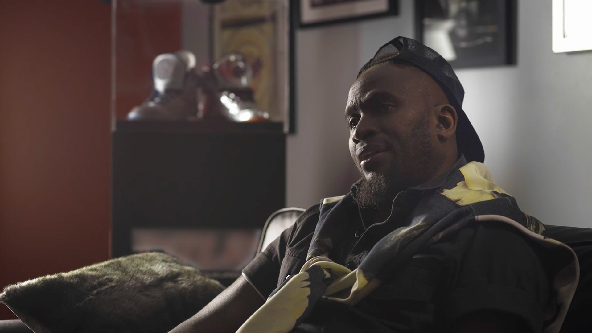 """Anwan """"Big G."""" Glover sits on a couch while filming some branded content for a mini-doc."""