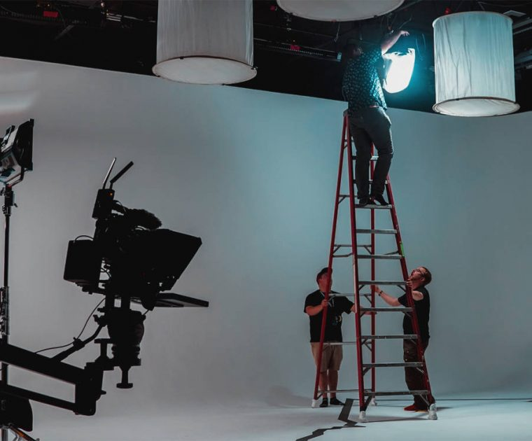 grip-and-gaff-hanging-lights-in-studio