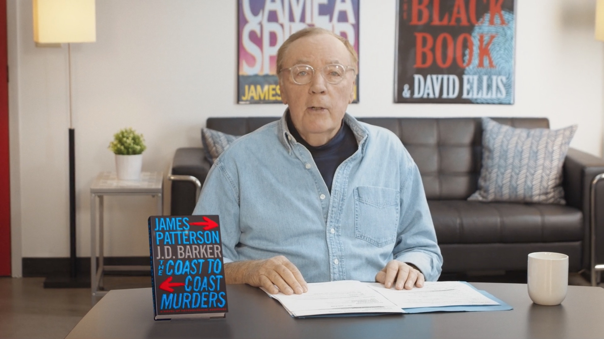 James Patterson at a table discussing his book Real Readers: The Coast to Coast Murders